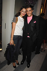 OSCAR HUMPHRIES and SARA PHILIPPIDIS at a preview of Garrard's new collections and celebrates a Kaleidoscope of Colour at Garrard, 24 Albemarle Street, London on 10th May 2007.<br />