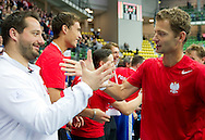 (L) trainer assistant Aleksander Charpantidis & (R) Mariusz Fyrstenberg both from Poland celebrate their victory at men's double game during second day of the BNP Paribas Davis Cup 2013 between Poland and South Africa at MOSiR Hall in Zielona Gora on April 06, 2013...Poland, Zielona Gora, April 06, 2013..Picture also available in RAW (NEF) or TIFF format on special request...For editorial use only. Any commercial or promotional use requires permission...Photo by © Adam Nurkiewicz / Mediasport