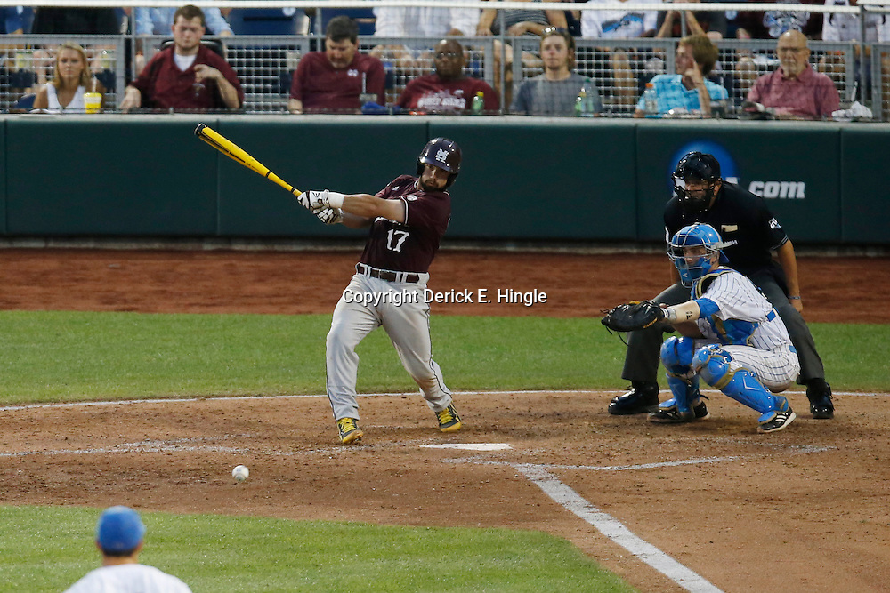 Jun 25, 2013; Omaha, NE, USA; Mississippi State Bulldogs catcher Nick Ammirati (17) hits a single in front of UCLA Bruins catcher Shane Zeile (right) during the fifth inning in game 2 of the College World Series finals at TD Ameritrade Park. Mandatory Credit: Derick E. Hingle-USA TODAY Sports