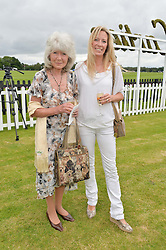 JILLY COOPER and her daughter EMILY COOPER at the Cartier Queen's Cup Final polo held at Guards Polo Club, Smith's Lawn, Windsor Great Park, Egham, Surrey on 15th June 2014.