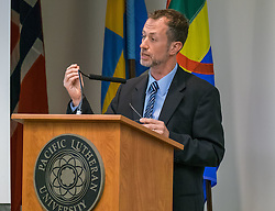 """Professor Stephen Mihm (University of Georgia)  delivers the annual Benson Lecture entitled """"The Futures Business:  Standards, Grades, and the Making of the Modern World.""""  visits a class at PLU, Tuesday, Oct. 11, 2016. (Photo: John Froschauer/PLU)"""
