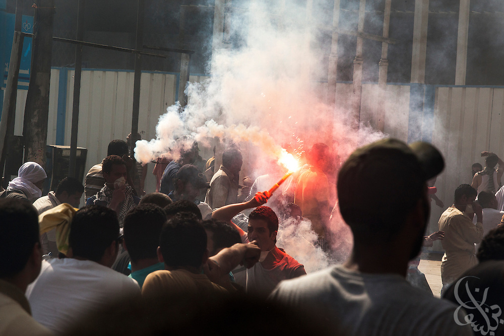 "Supporters of deposed Egyptian President Mohamed Morsi swarm towards the frontline of intense street clashes near Ramsis Square during the August 16, 2014 ""Day of Rage"" protests in Cairo, Egypt."