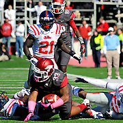 Mississippi defensive back Senquez Golson (21) watches as a tackle is made during an NCAA college football game against Arkansas in Little Rock, Ark., Saturday, Oct. 27, 2012. (Photo/Thomas Graning)
