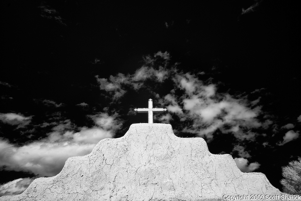 A cross on top of the San Lorenzo Church in Picuris Pueblo, New Mexico