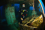 Israel, Eilat, Red Sea, - Underwater photograph of a diver in a sunken boat