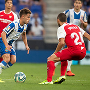 BARCELONA, SPAIN - August 18:  Oscar Melendo #14 of Espanyol defended by Joan Jordan #24 of Sevilla during the Espanyol V  Sevilla FC, La Liga regular season match at RCDE Stadium on August 18th 2019 in Barcelona, Spain. (Photo by Tim Clayton/Corbis via Getty Images)