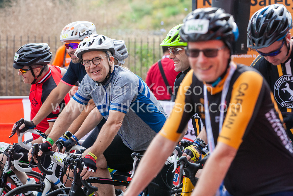 London, UK. 4 August, 2019. Tom Watson, Deputy Leader of the Labour Party, prepares to join around 4,500 riders starting the Prudential RideLondon-Surrey 46 in Queen Elizabeth Olympic Park in East London. An intermediate sportive event intended for younger riders and for those getting into mass-participation cycling, the Prudential RideLondon-Surrey 46 event takes place on 46 miles of traffic-free roads in London and Surrey before finishing on the Mall in front of Buckingham Palace.