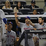 Lucas Duda, (left), New York Mets, is congratulated by team mates after scoring a run during the New York Yankees V New York Mets, Subway Series game at Yankee Stadium, The Bronx, New York. 12th May 2014. Photo Tim Clayton