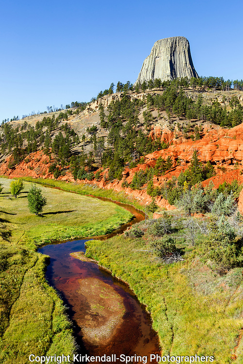 WY02265-00...WYOMING - Devils Tower with the Red Beds and Belle Fourche River in Devils Tower National Monument.