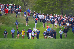 May 19, 2019 - Farmingdale, NY, U.S. - FARMINGDALE, NY - MAY 19:   Brooks Koepka of the United States walks down the 18th fairway followed by fans during the final round of the 2019 PGA Championship at the Bethpage Black course with a score of 8 under par on May 19, 2019 in Farmingdale, New York.(Photo by Rich Graessle/Icon Sportswire) (Credit Image: © Rich Graessle/Icon SMI via ZUMA Press)