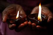 Lamps in hands... small devale near Ratnapura.