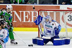 Adam Munro (SAPA Fehervar AV19, #51) with a save during ice-hockey match between HDD Tilia Olimpija and SAPA Fehervar AV19 at sixth match in Quarterfinal  of EBEL league, on March 1, 2012 at Hala Tivoli, Ljubljana, Slovenia. HDD Tilia Olimpija won 4:3. (Photo By Matic Klansek Velej / Sportida)