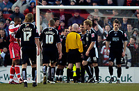 Photo: Jed Wee.<br />Doncaster Rovers v Swansea City. Coca Cola League 1.<br />17/12/2005.<br />Swansea surround referee Dermott Gallagher (C) to protest his award of a penalty against them.