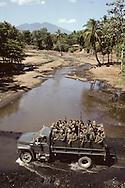 El Salvador. wounded soldier during a fighting  on the panamerican highway, destroyed convoy       / convoi detruit par la guerilla sur la route panamericaine et soldat blesse    Salvador  / SALV34105 1