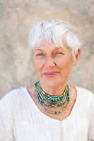 Portrait of a lovely and graceful senior woman wearing jewelry by Art Medicine Adornment.