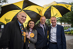 © Licensed to London News Pictures. 01/05/2017. London, UK. Liberal Democrat party leader Tim Farron (R) poses with Parliamentary candidates Vince Cable (L), Sarah Olney and Ed Davey - as a day of campaigning begins in Kingston-Upon-Thames. The general election is on June 8th 2017. Photo credit: Peter Macdiarmid/LNP