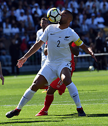 New Zealand's Winston Reid plays in front of Peru's Jefferson Farfan in the Soccer World Cup qualifying match, Westpac Stadium, Wellington, New Zealand, Saturday, November 11, 2017. Credit:SNPA / Ross Setford  **NO ARCHIVING**