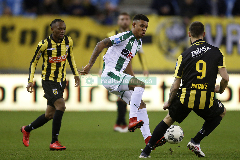 (L-R), Thulani Serero of Vitesse, Junhinho Bacuna of FC Groningen, Tim Matavz of Vitesse during the Dutch Eredivisie match between Vitesse Arnhem and FC Groningen at Gelredome on February 02, 2018 in Arnhem, The Netherlands