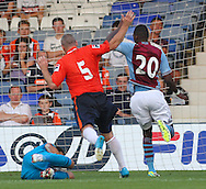 Picture by David Horn/Focus Images Ltd +44 7545 970036<br /> 23/07/2013<br /> Mark Tyler  of Luton Town saves a shot from Christian Benteke of Aston Villa while Steve NcNulty looks on during the Pre Season Friendly match at Kenilworth Road, Luton.