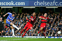 Photo: Tom Dulat.<br /> <br /> Chelsea v Queens Park Rangers. FA Cup Third Round. 05/01/2008. <br /> <br /> Chelsea's Claudio Pizarro scores his opener of the game. Chelsea leads 1-0. QPR's Fitz Hall (L) and Gavin Mahon (R) failed to stop the ball.