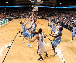 Virginia forward Mike Scott (32) shoots over North Carolina forward Tyler Hansbrough (50).  The Virginia Cavaliers men's basketball team fell to the #3 ranked North Carolina Tar Heels 75-74 at the John Paul Jones Arena in Charlottesville, VA on February 12, 2008.