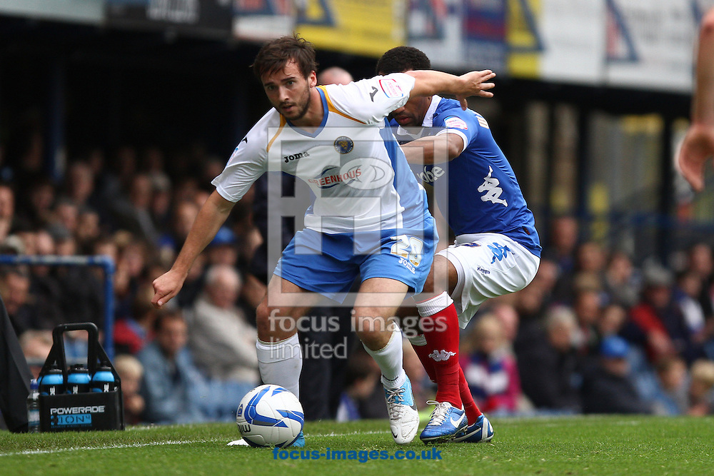 Picture by Daniel Chesterton/Focus Images Ltd +44 7966 018899.20/10/2012.Aaron Wildig of Shrewsbury Town and Lee Williamson of Portsmouth during the npower League 1 match at Fratton Park, Portsmouth.