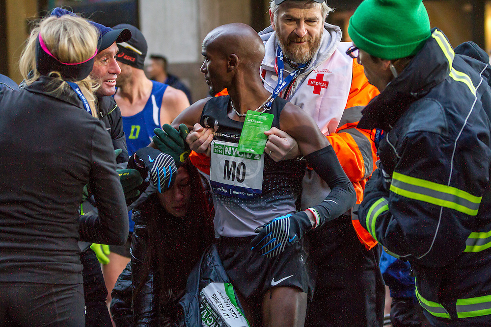 Mo Farah receives medical attention after fainting after finishing race