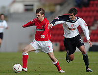 Photo. Leigh Quinnell.  Swindon Town v Walsall Coca Cola league one. 09/04/2005. Swindons Sammy Igoe holds off a challenge from Walsalls Andrew surman.