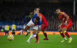 Theo Walcott of Everton (L) is tackled by Onel Hernandez and Sam Byram (C) of Norwich City - Mandatory by-line: Jack Phillips/JMP - 23/11/2019 - FOOTBALL - Goodison Park - Liverpool, England - Everton v Norwich City - English Premier League