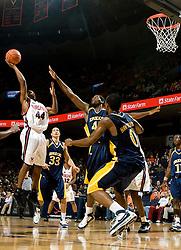 Virginia guard Sean Singletary (44) shoots over Drexel forward Kenny Tribbett (42).  The #23 Virginia Cavaliers men's basketball team defeated Drexel Dragons 72-58 at the John Paul Jones Arena in Charlottesville, VA on November 20, 2007.
