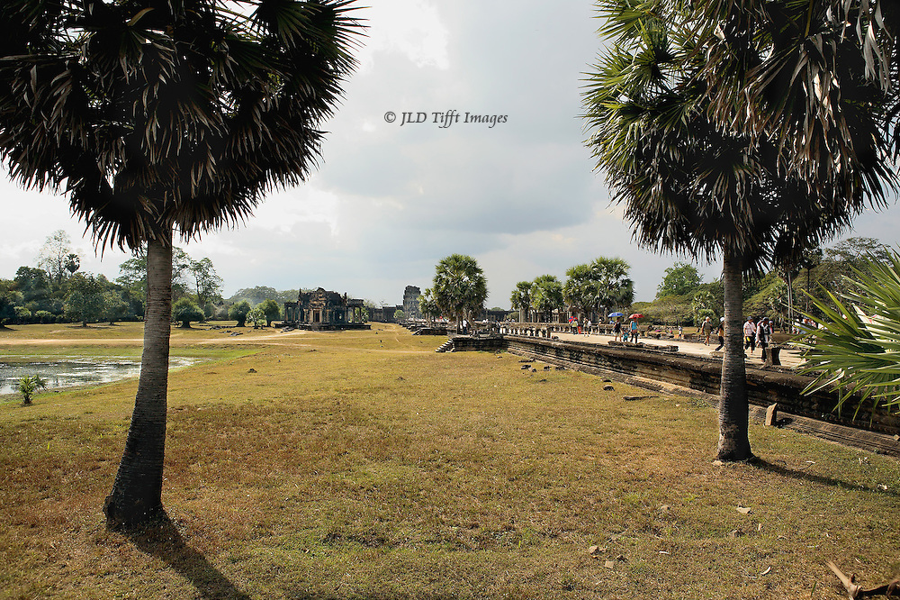 Angkor Wat: west entrance gateway and the 820 foot long causeway, looking toward the temple.  Subsidiary buildings just visible in the distance.  The long approach is meant to convey the journey from earth to heaven in the temple precinct.