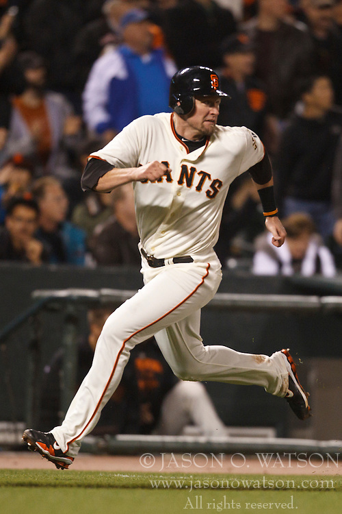 August 30, 2010; San Francisco, CA, USA;  San Francisco Giants first baseman Aubrey Huff (17) rounds third base to score a run against the Colorado Rockies during the fourth inning at AT&T Park.