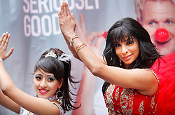 © under license to London News Pictures. 04/02/11 Shobna-Gulati with a dancers from teh Hina and Co Bollywood dancers. Gordon Ramsey and Shobna-Gulati help promote Red Nose Day in Brick Lane. Seriously Good Indian sauces will sell curry at a stall today to raise money for red nose day 2011. Photo credit should read: Olivia Harris/ London News Pictures