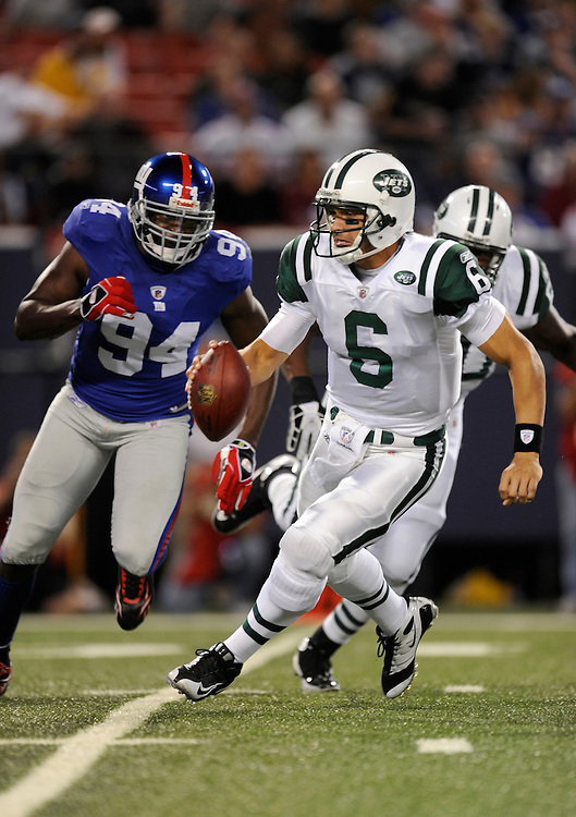 EAST RUTHERFORD, NJ - AUGUST 29: Mark Sanchez #6 of the New York Jets tries to escape the rush of Mathias Kiwanuka #94 of the New York Giants in a preseason game at Giants Stadium on August 29, 2009 in East Rutherford, New Jersey. The New York Jets beat the New York Giants 27-25. (Photo by Rob Tringali/ ) *** Local Caption *** Mark Sanchez;Mathias Kiwanuka