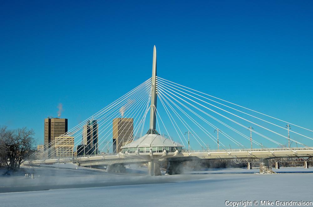 Winnipeg skyline and Esplanade Riel Bridge over the Red River<br /> Winnipeg<br /> Manitoba<br /> Canada