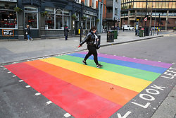 © Licensed to London News Pictures. 17/02/2020. London, UK. A woman crosses at a second LGBT (Lesbian, gay, bisexual, transgender) rainbow-coloured crossing that has been installed in Haringey, north London in celebration of LGBT History Month. This comes after a rainbow coloured crossing was installed early this month outside a school in Haringey which has received around 200 abusive messages on social media for the installation. Photo credit: Dinendra Haria/LNP