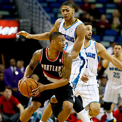 Feb 13, 2013; New Orleans, LA, USA; New Orleans Hornets power forward Anthony Davis (23) guard Portland Trail Blazers point guard Damian Lillard (0) during the second quarter of a game at the New Orleans Arena. Mandatory Credit: Derick E. Hingle-USA TODAY Sports