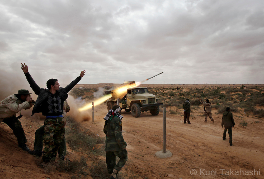 Rebel soldiers against Col. Muammar Gaddafi fire Katyusha rocket at frontline near Ras Lanuf on March 9, 2011. The government military and rebels kept fighting for taking control of the town for the last two days. .Photo by Kuni Takahashi