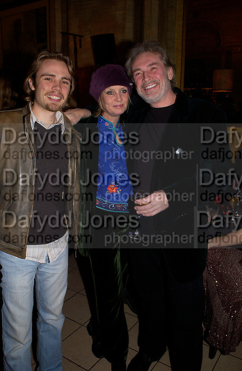 Leigh Lawson and Twiggy, Krug Christmas party, hosted by Sir Trevor Nunn and Imogen Stubbs, the Criterion, 10 December 2003. © Copyright Photograph by Dafydd Jones 66 Stockwell Park Rd. London SW9 0DA Tel 020 7733 0108 www.dafjones.com