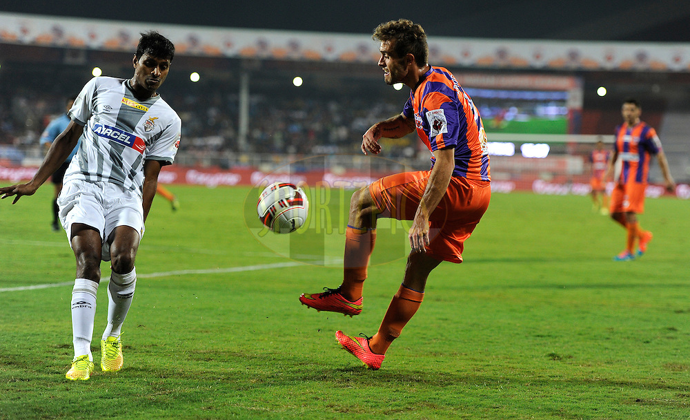 Davide Colomba of FC Pune City and Arnab Kumar Mondal of Atletico de Kolkata in action during match 44 of the Hero Indian Super League between FC Pune City and Atletico de Kolkata FC held at the Shree Shiv Chhatrapati Sports Complex Stadium, Pune, India on the 29th November 2014.<br /> <br /> Photo by:  Pal Pillai/ ISL/ SPORTZPICS