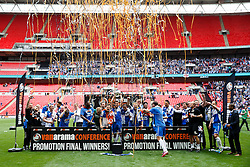Bristol Rovers lift the trophy at the winners board after they win the match on penalties  to secure promotion to the Football League 2 - Photo mandatory by-line: Rogan Thomson/JMP - 07966 386802 - 17/05/2015 - SPORT - FOOTBALL - London, England - Wembley Stadium - Bristol Rovers v Frimsby Town - Vanarama Conference Premier Play-off Final.