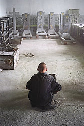 A prisoner work in a small factory where create the tombstones from granite at the colony for prisoner's children in Siberian town Leninsk-Kuznetsky, Russia, 15 January 2001.