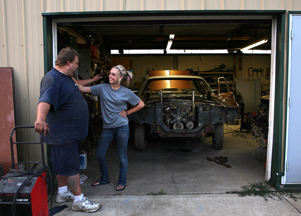 Taylor and her father Kevin work on her demolition derby car at their home in Crown Point earlier this month. ....