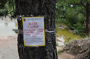 Signs posted along the Animas River proclaim the river closed by order of the La Plata County Sheriffs office to all forms of recreation until further notice.