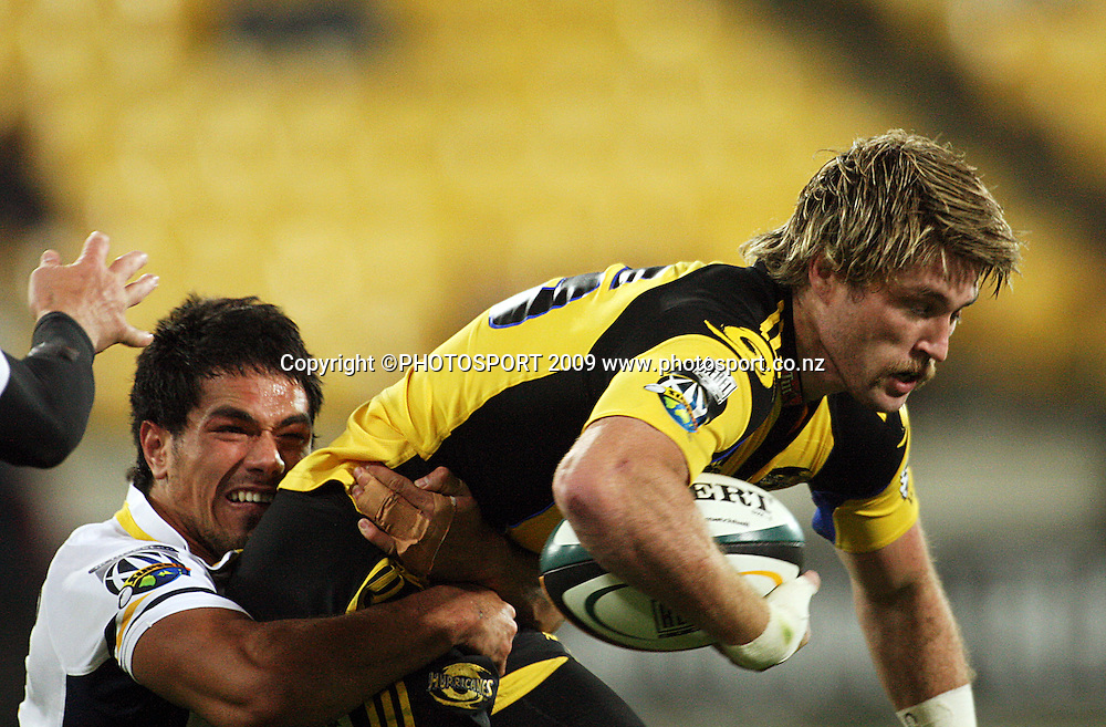 Brumbies winger Alfi Mafi tries to tackle Cory Jane.<br /> Super 14 rugby union match, Hurricanes v Brumbies, Westpac Stadium, Wellington, New Zealand. Saturday 25 April 2009. Photo: Dave Lintott/PHOTOSPORT