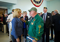 Senator Maggie Hassan speaks with Ray Goulet president of the Vietnam Veterans of America, NH during the Veterans Day ceremony at the NH Veterans Home on Friday morning.  (Karen Bobotas/for the Laconia Daily Sun)