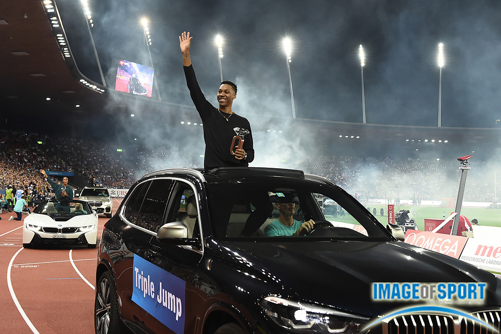 Juan Miguel Echevarria (CUB) takes victory lap with the IAAF Diamond League championship trophy after winning he long jump at 28-4 1/2 (8.65m) during the Weltkasse Zurich at Letzigrund Stadium, Thursday, Aug. 29, 2019, in Zurich, Switzerland. (Jiro Mochizuki/Image of Sport)