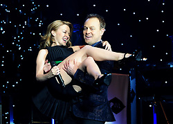 File photo dated 21/12/12 of Kylie Minogue and Jason Donovan during the Hit Factory Live Christmas Cracker concert, at the O2 arena in London. The pop star and actress turns 50 on Monday.