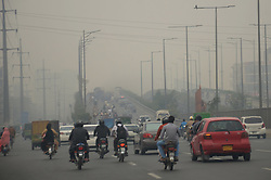 November 3, 2018 - Lahore, Punjab, Pakistan - Motorists on their way as smog continues. Smog has once again engulfed Lahore and is expected to stay for a few more days. It is a type of air pollution caused by smoke and fog. T (Credit Image: © Rana Sajid Hussain/Pacific Press via ZUMA Wire)