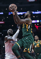 January 16, 2019 - Los Angeles, California, United States of America - Montrezl Harrell #5 of the Los Angeles Clippers is unable to block Royce O'Neale #23 of the Utah Jazz during their NBA game  on Wednesday January 16, 2019 at the Staples Center in Los Angeles, California. Clippers lose to Jazz, 129-109. JAVIER ROJAS/PI (Credit Image: © Prensa Internacional via ZUMA Wire)